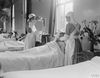 Members of the VAD feeding a convalescent patient at the Royal Naval Hospital, Granton. © IWM (Q 18952)