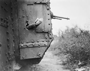 Carrier pigeon being released from a tank. 1918. © IWM (Q 9247)
