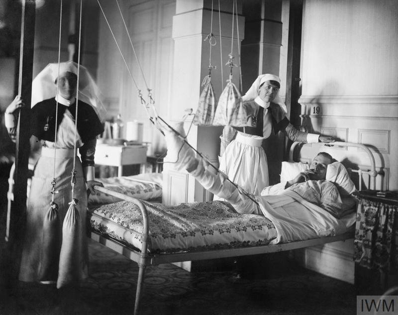 Queen Alexandra's Imperial Military Nursing Service (QAIMNS) Sisters attending to a patient at Wimereux. © IWM (Q 8011)