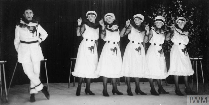 Members of the VAD providing Christmas entertainment for the patients. 1917. © IWM (Q 108171)