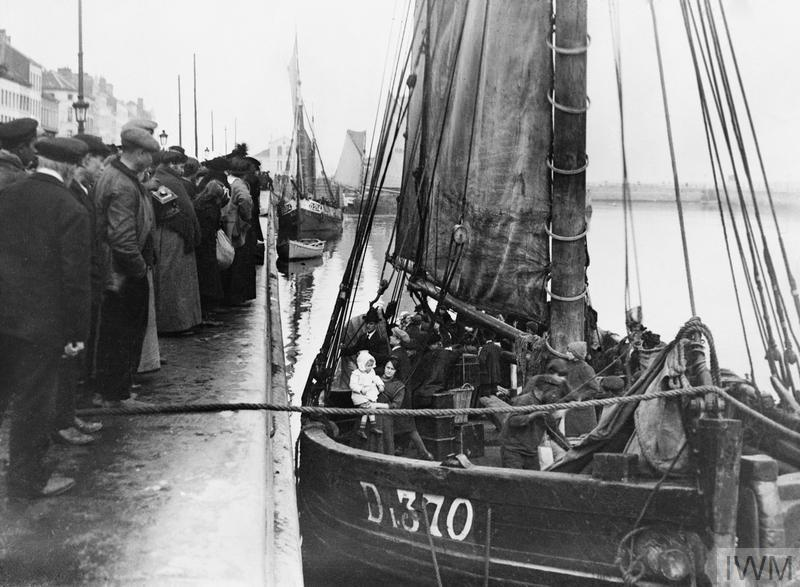 Families of Belgian refugees prepare to leave Ostend in a trawler. 16 October, 1914. © IWM (Q 53340)