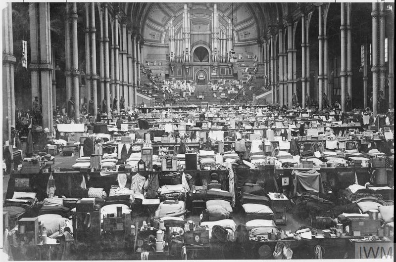 Sleeping quarter in the Great Hall at Alexandra Palace. © IWM (Q 64157)