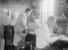 Medical staff in the laboratory of No.9 Red Cross Hospital (Millicent Sutherland Ambulance) at Calais, July 1917. © IWM (Q 2613)