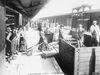 Female munition workers unloading shells from a railway wagon at Newbury Station. © IWM (Q 110251)