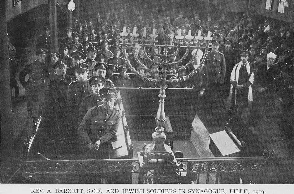 Jewish soldiers in the Synagogue in Lille, with Rev. A Barnett, 1919.