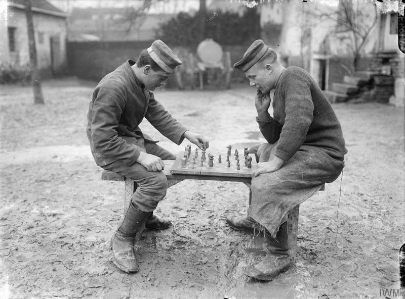 The Battle of the Somme. German prisoners playing chess, Querrieu, October 1916 © IWM (Q 1599)