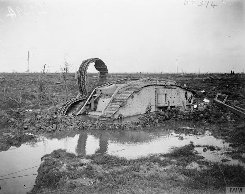 A knocked out British tank half submerged in mud and water near St Julien, 12/10/1917. © IWM (Q 6327)
