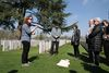 Lijssenthoeck CWGC with Paula Kitching talking to group. We Were There Too trip to Ypres, April 2017. By Alan Brill, Voluntary Photographer