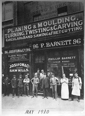 Photograph of Phillip Barnett outside his cabinet making shop at 96, Curtan road, London EC. 1910. ©Jewish Museum London